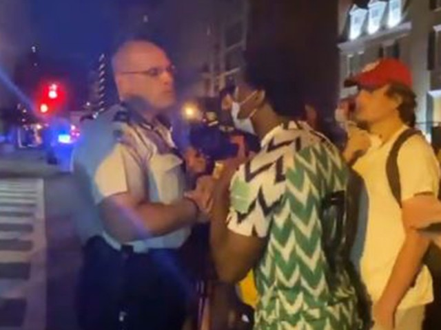 Protesters Harass Black Officers: 'Nothing but House N***ers'