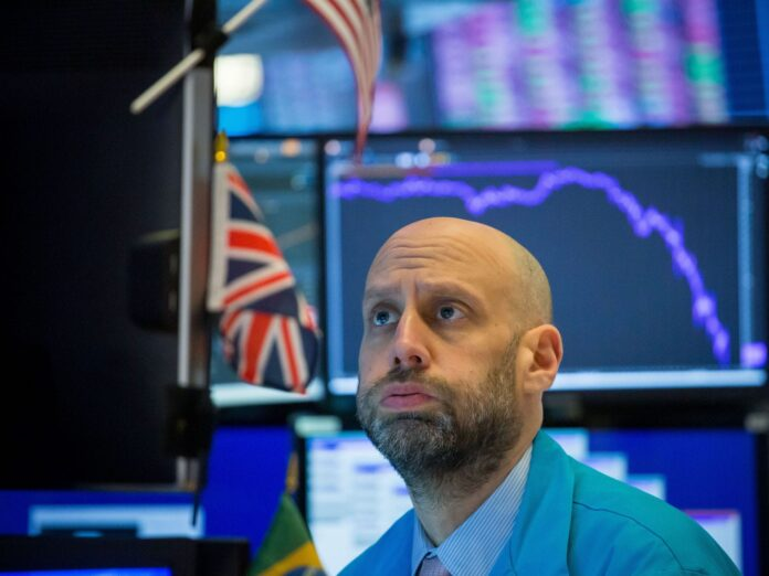 US stocks fall from record heights as virus concerns persist